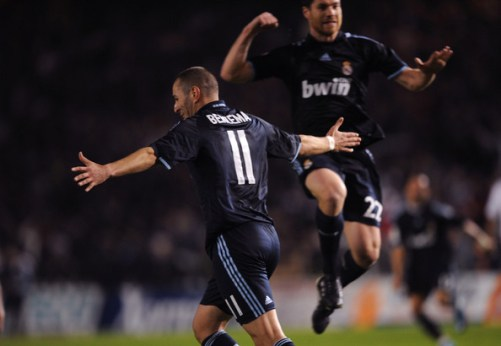 Karim Benzema (L) of Real Madrid celebrates after scoring Real's third goal during the La Liga match between Real Madrid and Deportivo La Coruna at the Riazor Stadium on January 30, 2010 in La Coruna, Spain.