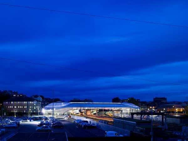 Night view of station car park, railway - Grimshaw