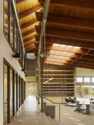 Board-formed concrete, glue-laminated structure and wood decking recall Ossipoff's chapel. Ample daylight floods the space from all directions strengthening a connection to the out- doors and eliminating the need for artificial lighting in the daytime
