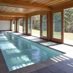 View of lap pool beneath deck and Master Bedroom: Image Courtesy © Peter Vanderwarker
