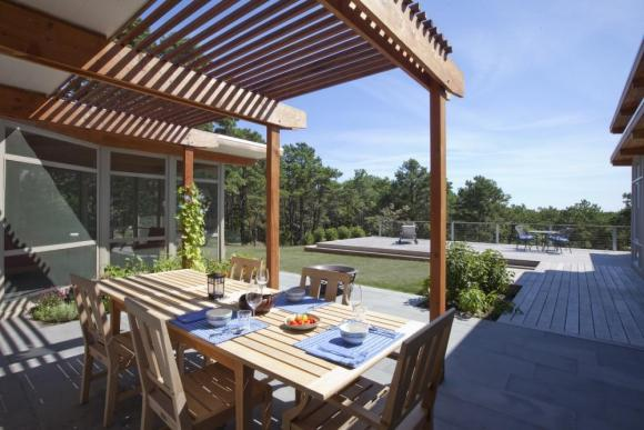 New shaded dining patio, located between dining room and screen porch: Image Courtesy © Peter Vanderwarker