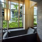 Junior suite bathroom with view looking towards sky terraces, Image Courtesy © Patrick Bingham-Hall