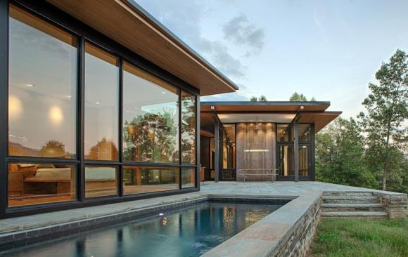 Lap pool and terrace with the master suite to the left, Image Courtesy © Carlton Architecture + DesignBuild