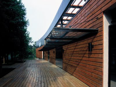 Wood deck along the north side of the building, Image Courtesy © Miao Design Studio