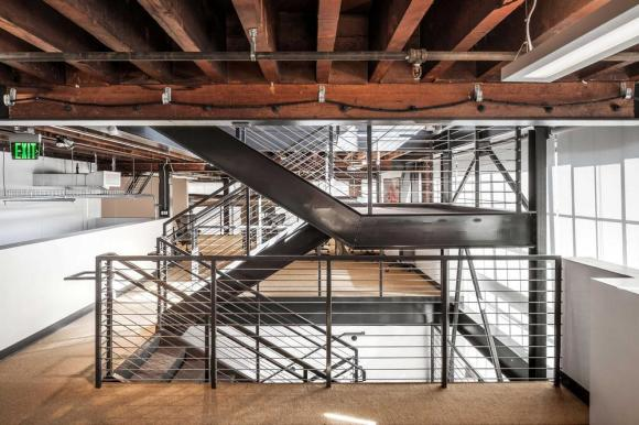 """Image Courtesy © Eddy Joaquim, SaA worked closely with the structural engineer on this new """"hanging"""" stair within the existing space, increasing the connections between the three levels of work areas."""