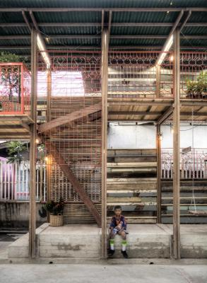 Image Courtesy © TYIN tegnestue Architects, View of part of the structure seen from the football court.