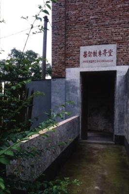 Image Courtesy © Pu Miao Architecture, A bridge before the main entrance, under the bridge is a preserved water hole.