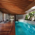 The cranked wooded ceiling reflects the water surface and simultaneously hides 	technology above. The water's flat-surface was designed with an overflow system covered with a wooden rim.  There's tight watercourse surrounding the pool  aimed to avoid pool's pollution. The wooden floor is designed as a marine floor., Image Courtesy © Tomáš Manina