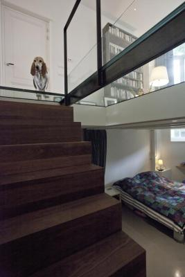 wooden cube/stairs with glass ceiling and small bedroom, Image Courtesy © Cornelie de Jong