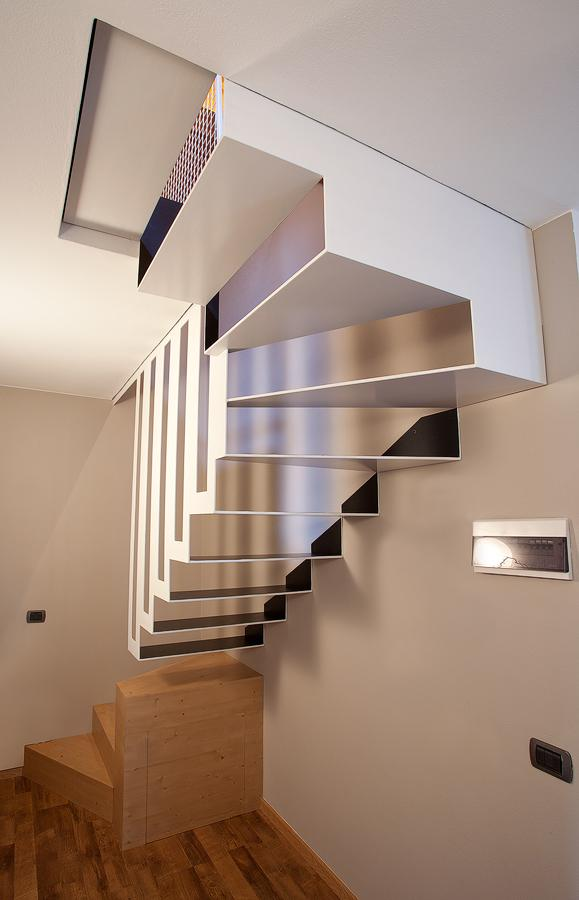 The metal staircase fills the space without filling it really!, Image Courtesy © BEAR Progetti