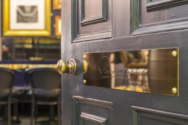 Brass signage on main entrance, Image Courtesy © Gareth Gardner