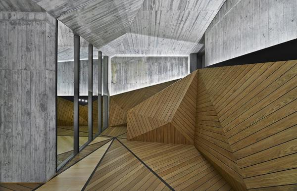 DETAIL OF THE WOODEN INTERIOR SHELL MIMICKING THE GEOMETRY OF THE BUILDING, Image Courtesy © Autoban