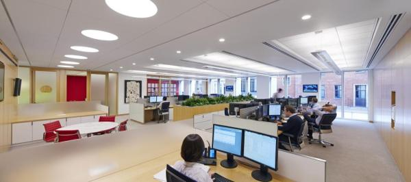 The open, light-filled trading area is designed for collaboration, Image Courtesy © Paul Riddle