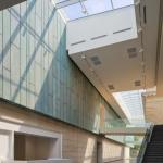 A new light-filled atrium welcomes Museum visitors. The admission desk is located to the left of the staircase that leads to the upstairs galleries. The bridges that join the historic Richard M. and Elizabeth M. Ross building and the new Margaret M. Walter Wing, Image Courtesy © Brad Feinknopf