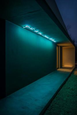 """The entrance with, """"More than yesterday, less than tomorrow"""" quoted above in neon, Image Courtesy © Alessandro Ruzzier"""