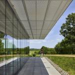 Solar Shade reduces heat gain on glass exterior while creating exterior terrace to Battlefield, Image Courtesy © Jeffrey Totaro