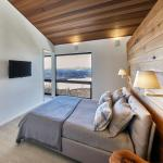 View of master bedroom looking west over Lac Archambault, Image Courtesy © Marc Cramer
