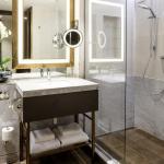 En suite bathroom with stone and ceramic walls, Image Courtesy © Gareth Gardner