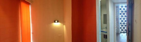 Guestroom orange color  scheme, Image Courtesy © Staek Photography