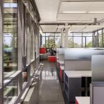 Glass enclosed office spaces provide views to the central campus as well as into the hub of the facility, Image Courtesy © Robert Canfield