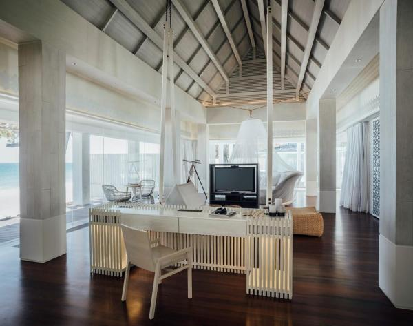 The color white and glass walls are incorporated to achieve a light, airy atmosphere as though the buildings are hovering above heaven. Furniture and accessories are authentically Thai yet modern. White is used liberally to convey the concept of a floating haven, Image Courtesy © Chaovarith Poonphol