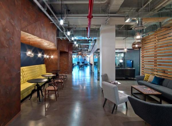 multi-seating collaboration area incorporating soft seating with more traditional café meeting spaces.  Raw, exposed materials for industrial aesthetic , Image Courtesy © Eric Laignel