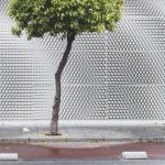 East facade_Printed ceramic pieces cover the facade, Image Courtesy © Alfonso Calza
