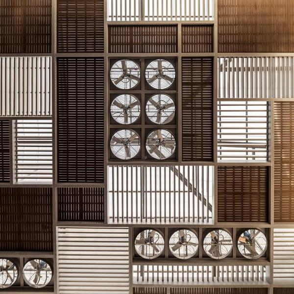 Industrial fans incorporated into the ceiling screen below the skylight effectively increase the air movement in extra hot days, Image Courtesy © W Workspace, Ketsiree Wongwan