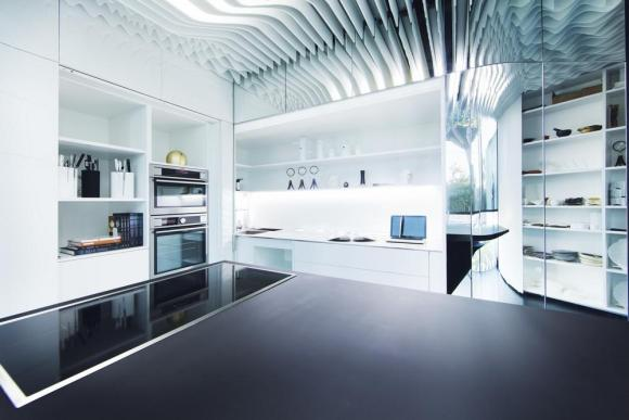 The kitchen island is a workspace and can also be used to serve the clients, Image Courtesy © Alfonso Calza