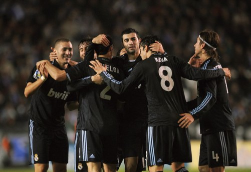 Karim Benzema (L) of Real Madrid celebrates with teammates after scoring Real's third goal during the La Liga match between Real Madrid and Deportivo La Coruna at the Riazor Stadium on January 30, 2010 in La Coruna, Spain.