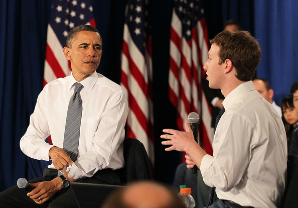 Mark Zuckerberg U.S. President Barack Obama (L) talks with Facebook CEO Mark Zuckerberg (R) during a town hall style meeting at Facebook headquarters on April 20, 2011 in Palo Alto, California. Obama held the Facebook town hall to answer questions about the deficit and the economy.