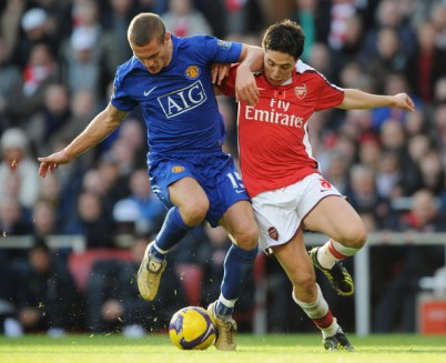 Samir Nasri of Arsenal tussles with Nemanja Vidic of Manchester United during the Barclays Premier League match between Arsenal and Manchester United at the Emirates Stadium on November 8, 2008 in London, England.