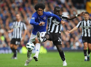 Cheik Tiote Marouane Fellaini of Everton holds off a challenge from Cheik Tiote of Newcastle United during the Barclays Premier League match between Everton and Newcastle United at Goodison Park on September 18, 2010 in Liverpool, England.