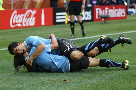 Luis Suarez of Uruguay celebrates scoring the opening goal with team mate Edinson Cavani during the 2010 FIFA World Cup South Africa Round of Sixteen match between Uruguay and South Korea at Nelson Mandela Bay Stadium on June 26, 2010 in Nelson Mandela Bay/Port Elizabeth, South Africa.