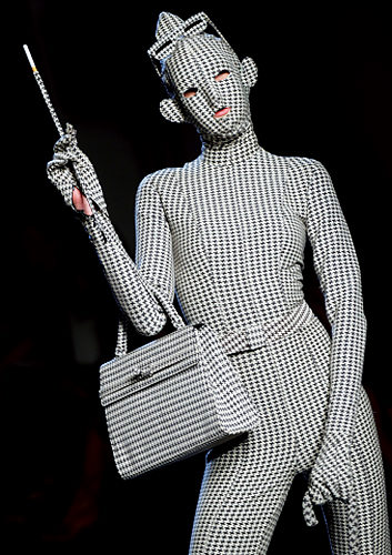 A model presents a creation by French de
