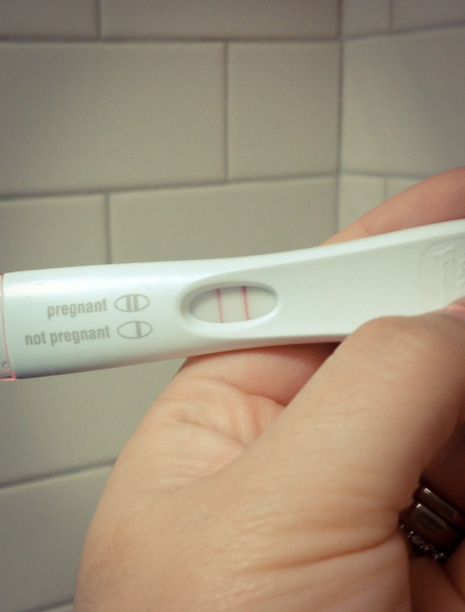This is the positive pregnancy test. I'm amazed the photo is in focus, since my hands were shaking so much.