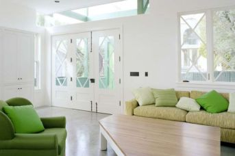 Accent-green-couch-and-cushions-provide-freshness-to-this-living-space-in-neutral-hues