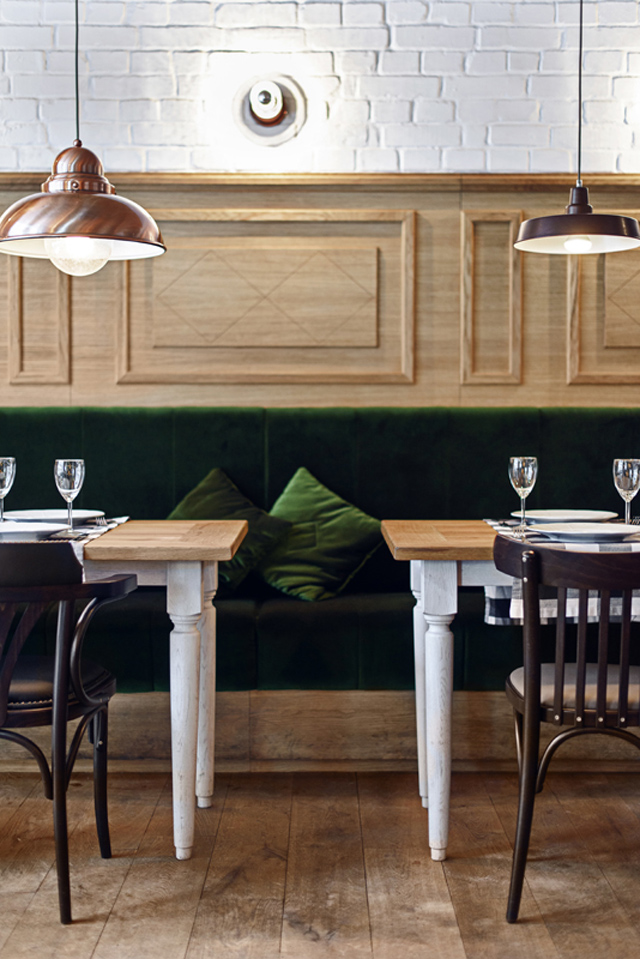 Althaus Restaurant, dining room, timber wall panelling, white painted brick walls, timber floor, green velvet upholstery