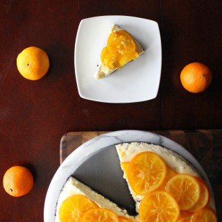 Clementine-Vanilla Bean Cheesecake with Chocolate Cooke Crust & Candied Clementines