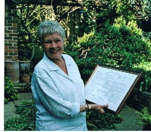 Our President Dame Judi Dench holding her family tree presented by the Society