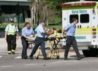 """Image of wounded person moved on a stretcher following the Orlando's shooting. Illustrating Shakespeare's quote, """"Twill vex thy soul to hear what I shall speak; for I must talk of murders"""" from Titus Andronicus"""