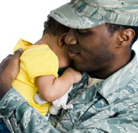 Military Dad hugging baby - AZVHV Veteran and Military Home Buyer Forum