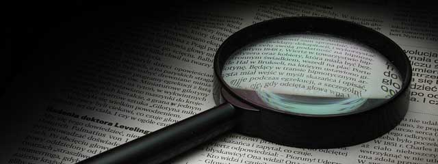 magnifier page letters newspaper