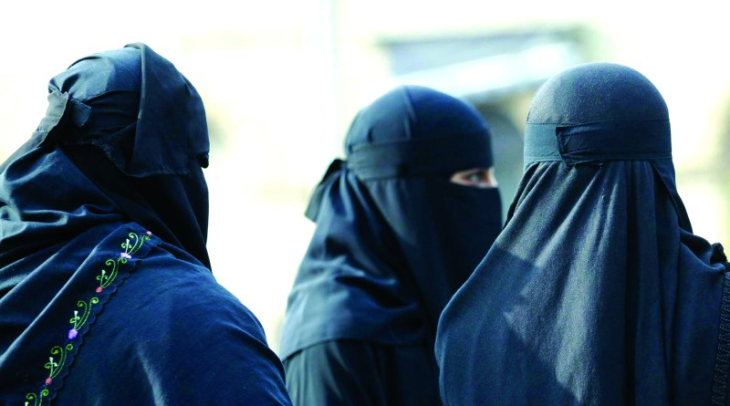 Muslim women wearing niqab face veils