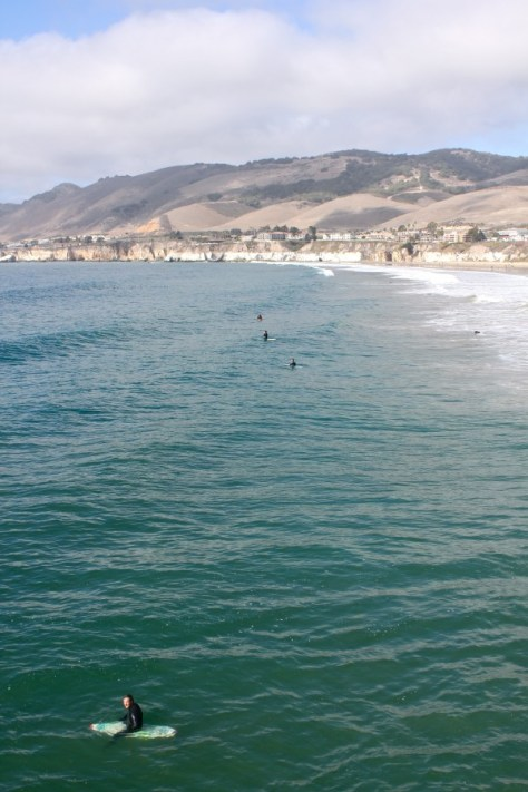 Surfer viewed from the Pismo Beach Pier, California via ZaagiTravel.com