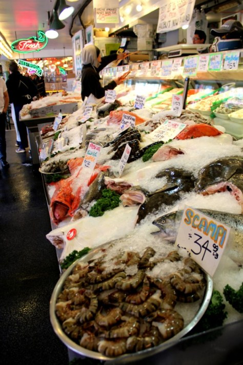 Fresh fish being sold in Pike Place Market in Seattle, Washington, United States via ZaagiTravel.com