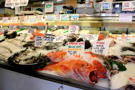 Fish being sold in Pike Place Market in Seattle, Washington, United States via ZaagiTravel.com