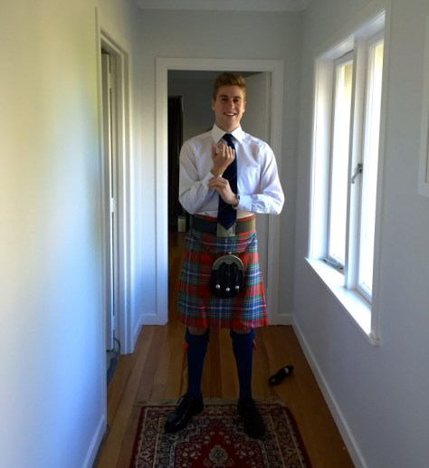 James in drum major uniform & kilt on Anzac Day morning via ZaagiTravel.com
