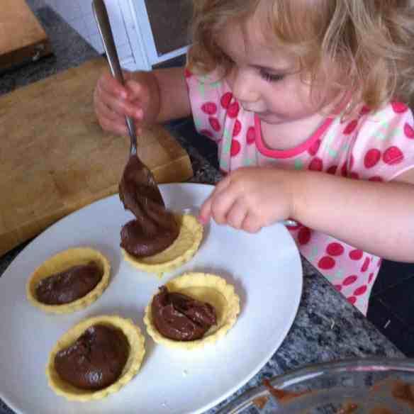 Toddler making tarts