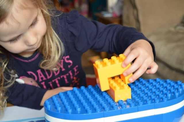 girl making boat